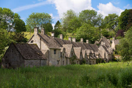 gloucestershire: Arlington Row in Bibury with River Coln, Cotswolds, Gloucestershire, UK Editorial