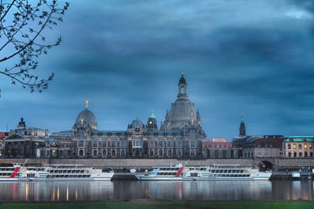 Elbe river with Church of Our Lady (Frauenkirche) before sunset, Dresden, Germany photo