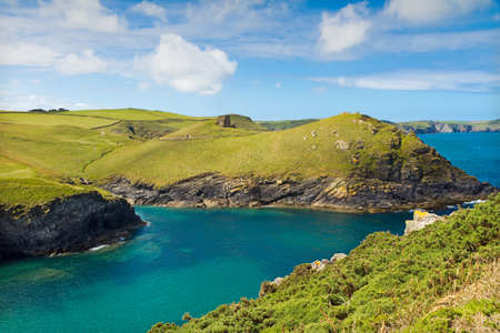 far off: Cove near Port Quin with deep blue sea, Cornwall with deep blue see, UK Stock Photo
