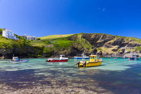 cornish: Colorful fishing boats at Harbour of Port Isaac, Cornwall, England Stock Photo