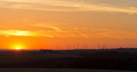 far off: Wind generators at sunset, Pfalz, Germany