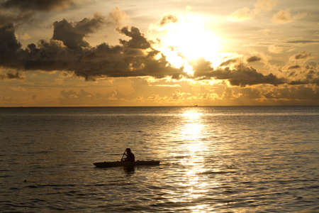 far off: Sunset at South China Sea with canoe in Phu Quoc close to Duong Dong, Vietnam
