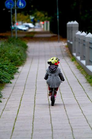 Three year old child with training bike photo