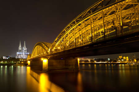 Cologne Cathedral and Hohenzollern Bridge at night, Cologne, Germany photo