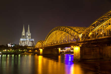 Cologne Cathedral and Hohenzollern Bridge at night, Cologne (Koeln), Germany photo