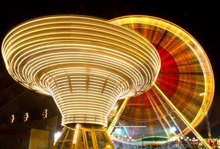 carrousel: Ferris wheel and carousel at county fair at night, Karlsruhe, Germany