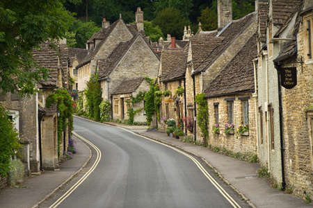 Cottages and main street in Castle Combe, Cotswolds, UK