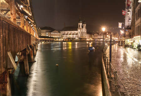Chapel Bridge (Kappelbruecke) with Jesuit Church at night, Lucerne, Switzerland Stock Photo - 11371987