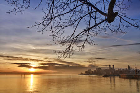 monastery nature: Bodensee (Lake Constance) with Schlosskirche (church) of Friedrichshafen at sunset, Germany