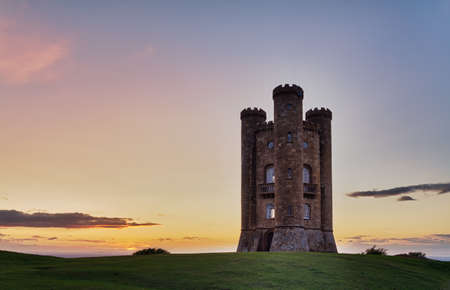 broadway tower: Broadway Tower at sunset with colorful sky, Cotswolds, UK Stock Photo
