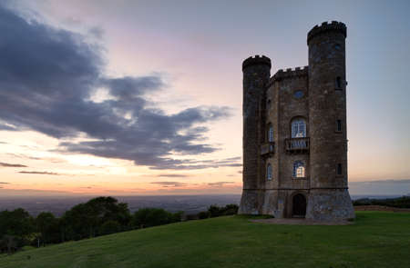 broadway tower: Broadway Tower with valley view after sunset Cotswolds, UK Stock Photo