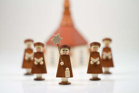 Handcrafted Carolers with white background, produced in Erz Mountains, Germany photo