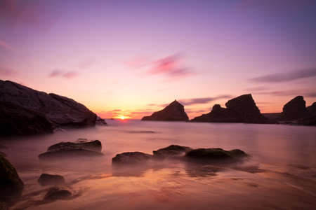 Bedruthan Steps at sunset with violet skies, Cornwall, England