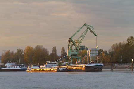 rhein: Barge at Rhein river at sunset near Karlsruhe, Germany Stock Photo