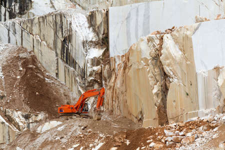 Marble quarry with  excavator in Carrara, Tuscany, Italy photo