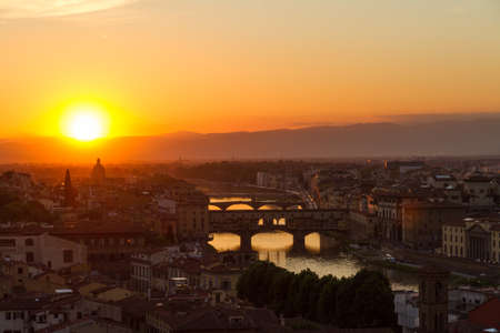 Florence with Arno River and Ponte Vecchio at sunset, Italy