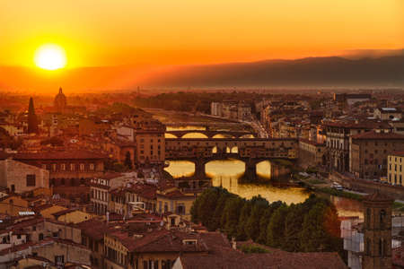 Florence, Arno River and Ponte Vecchio at sunset, Italy photo