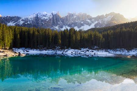 Lago di Carezza  Karersee  with Alps and blue skies, Südtirol, Italy photo