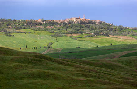 Skyline of Pienza with clouded sky, Val dOrcia, Tuscany, Italy photo