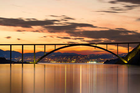 Bridge to Krk Island at sunset, Croatia photo