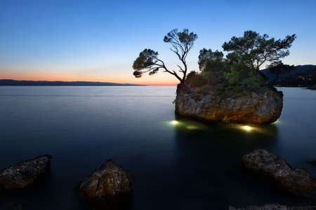 Sunset at beach with Kamen Brela (Brela Stone), Brela, Adriatic Sea, Croatia photo