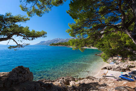 Bay at Croatian beach at a sunny day, Brela, Croatia photo