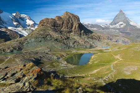 Panaroma in Swiss Alps with Rifelsee and Matterhorn, Switzerland Standard-Bild