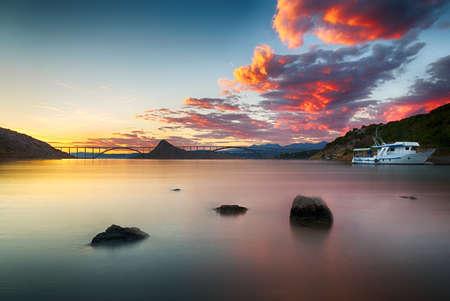 Krk bridge at dusk with colorful sunset, Croatia Standard-Bild