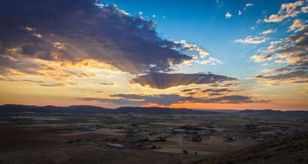 far off: Sunset near Consuegra, Castile-La-Mancha, Spain Stock Photo