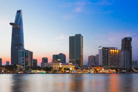 city hotel: SAIGON (HO CHI MINH CITY), VIETNAM - JANUARY  2014: Skyline of Saigon with Saigon River