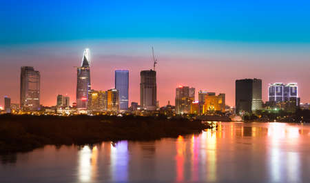 Saigon skyline with river after sunset, Vietnam Stock Photo