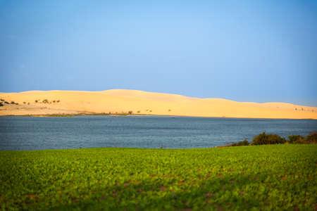 ne: White Sand Dunes and blue lake, Mui Ne, Vietnam