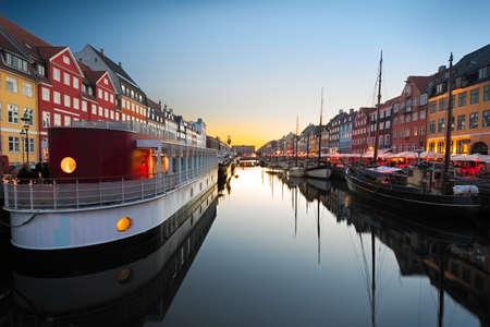 sailboats: Ships in Nyhavn at sunset, Copenhagen, Denmark