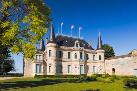 palmer: BORDEAUX, FRANCE -  MAY 2014: Chateau Palmer - one of the most famous winemakers in France at a cloudless day