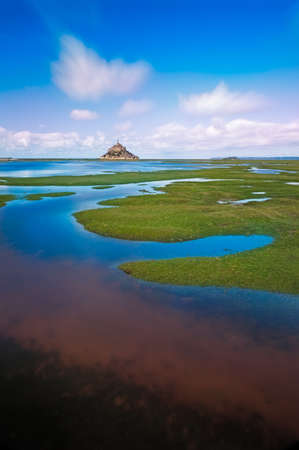 cropland: Mont Saint-Michel with clouds at a sunny day, Normandy, France
