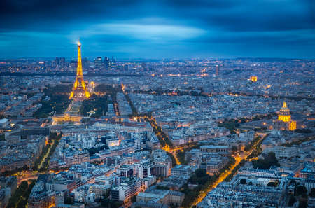 highriser: PARIS, FRANCE - AUGUST 20, 2014 - Illuminated Eifel Tower at dusk on a clouded day Editorial