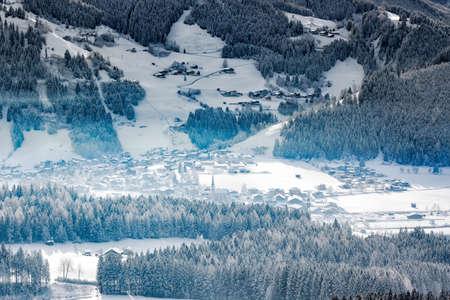 far off: Wintery village in alpine valley, Tyrol, Austria