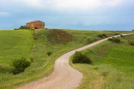cropland: Tuscany farmhouse with lightning at horizon, Pienza, Italy Stock Photo