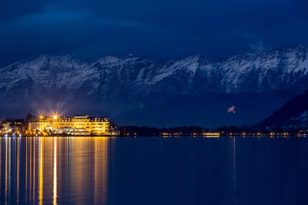 meer: ZELL AM SEE, AUSTRIA - JANUARY 05, 2016 - Grand Hotel in front of Steinernes Meer Rocky Sea mountain range at winter time