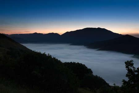 far off: Fog over Piano Grande, Castelluccio, Umbria, Italy