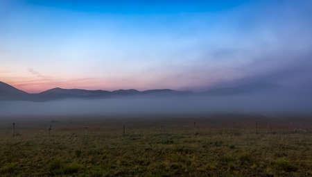 far off: Morning fog at Piano Grande, Castelluccio, Umbria, Italy