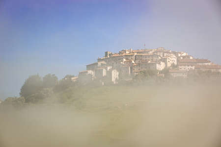 far off: Castelluccio in morning fog, Piano Grande, Umbria, Italy