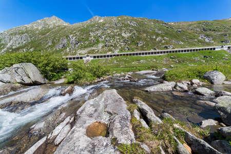 far off: Historic Gotthard pass road, Alps, Switzerland Stock Photo