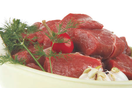 green stuff: uncooked meat : raw fresh beef pork fillet ready to cooking with garlic and green stuff.