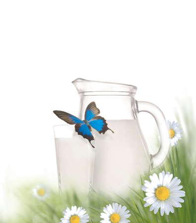 milk jug: Fresh milk jug and glass with green meadow