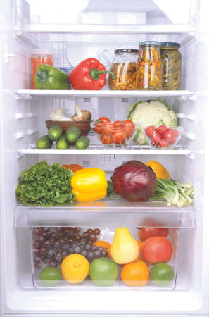 refrigerator: refrigerator full of healthy food. fruits, vegetables and dairy products