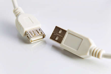 Cable connector micro-USB to USB on white background.