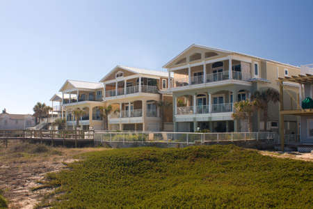 New beach house by the boardwalk in early morning sun Stock Photo