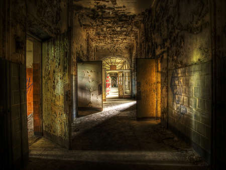old abandoned room of rays of light through the window. The old mysterious building Stock Photo