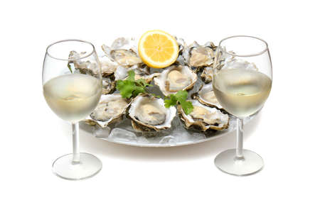 Dish with oysters and lemon isolated on a white background. Seafood. Healthy natural foods. Stock Photo